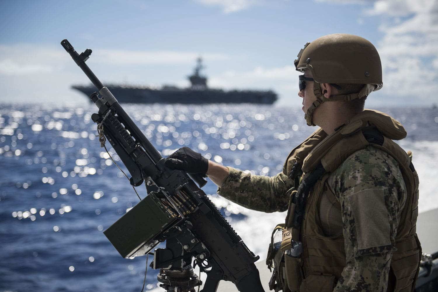 CRS 2 Escorts USS Roosevelt to Apra Harbor U.S. Navy Operations Specialist 2nd Class Jacob Owen, assigned to Coastal Riverine Squadron (CRS) 2, mans an M240G machine gun aboard a MK VI patrol boat while providing high value asset protection for the aircraft carrier USS Theodore Roosevelt as it transits (CVN 71) to Apra Harbor, Guam.