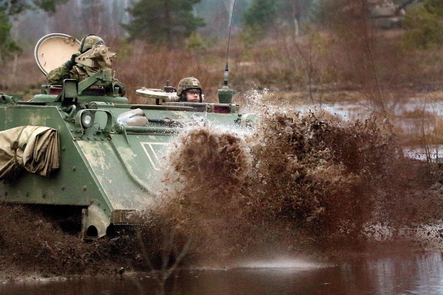Soldiers assigned to 5th Squadron, 4th Cavalry Regiment, 2nd Armored Brigade Combat Team, 1st Infantry Division ford water during training in Adazi, Latvia.