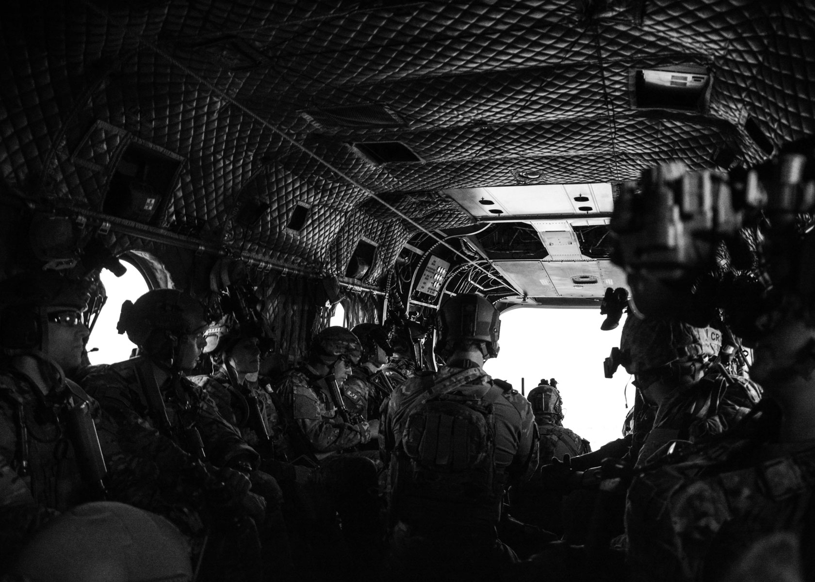 Green Berets from 10th Special Forces Group (Airborne) sit inside a CH-47 Chinook helicopter as they conduct a training exercise.
