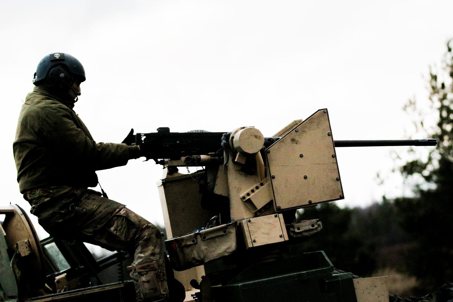 "2nd Lt. Ross Downum, a Lathrop, Calif. native and a platoon leader in ""Tomahawk"" Company fires a .50 caliber machine gun from the top of an M1A2 Abrams tank during training."