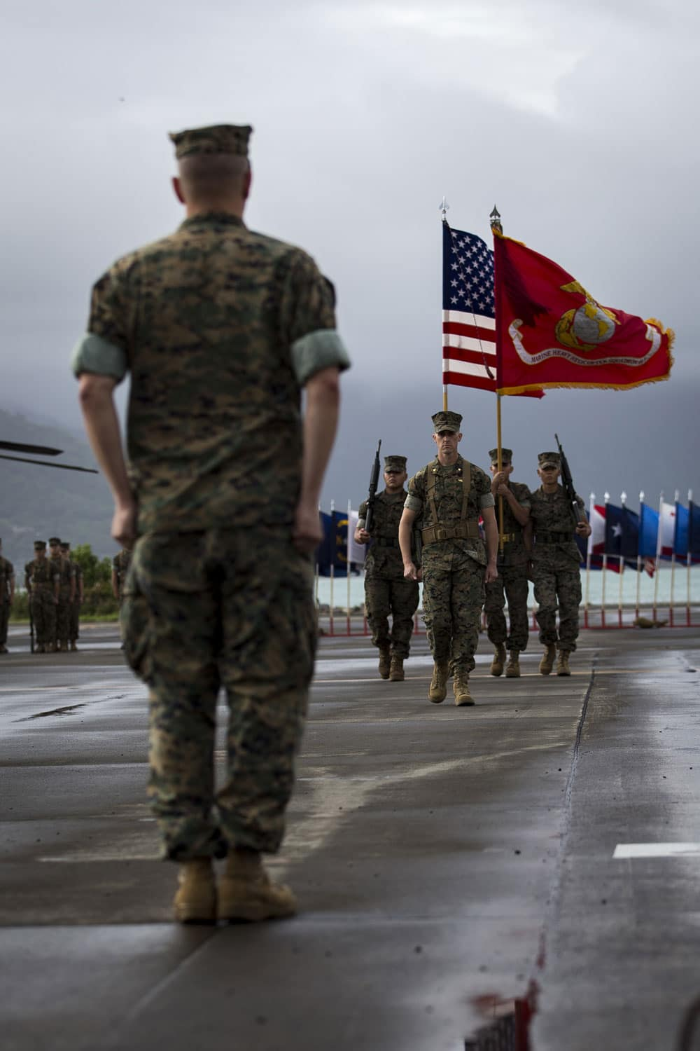 U.S. Marine Corps Maj. David J. Bachta, commander of troops for the Marine Heavy Helicopter Squadron 463 Change of Command, marches the colors.