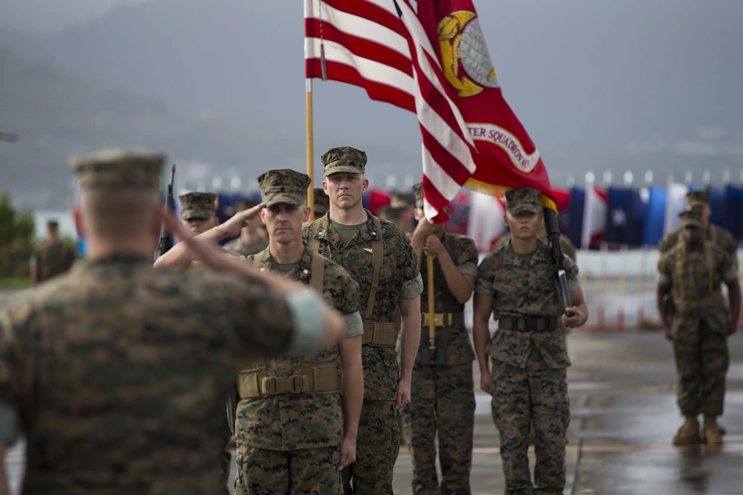 U.S. Marine Corps Maj. David J. Bachta, commander of troops for the Marine Heavy Helicopter Squadron 463 Change of Command, salutes Col. Christopher Patton, commanding officer, Marine Aircraft Group 24.