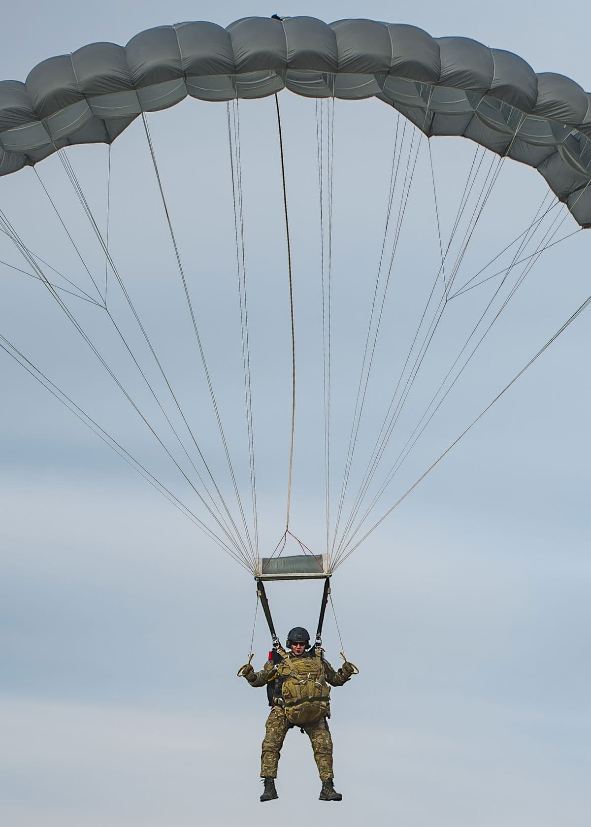 Chief Master Sgt. Mike Ziegler, 308th chief enlisted manager and pararescueman, parachutes to recover a simulated patient behind enemy territory.