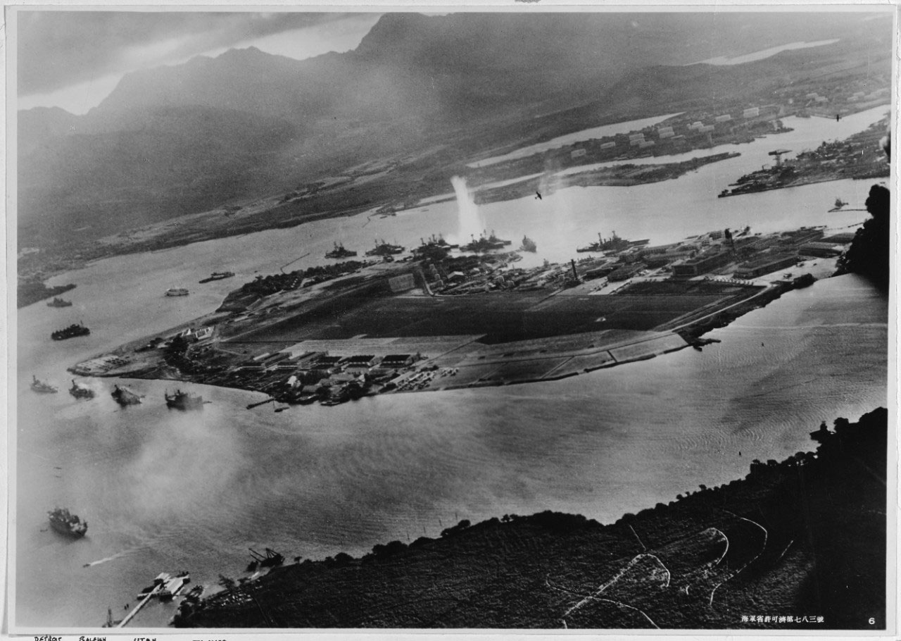Photograph taken from a Japanese plane during the torpedo attack on ships moored on both sides of Ford Island, Dec. 7, 1941.