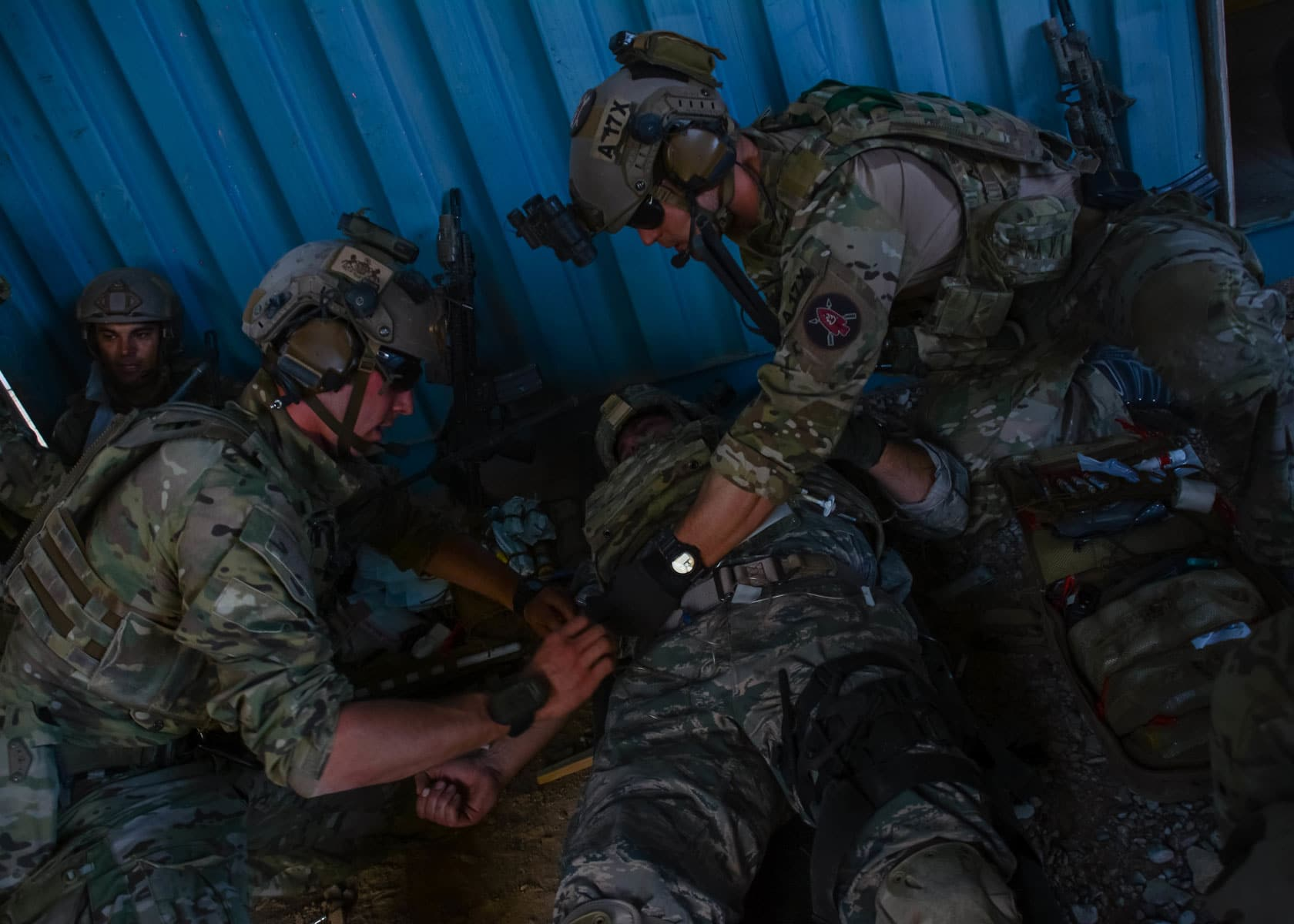 Special Forces Medics from 10th Special Forces Group (Airborne) evaluate a simulated casualty during a training exercise.