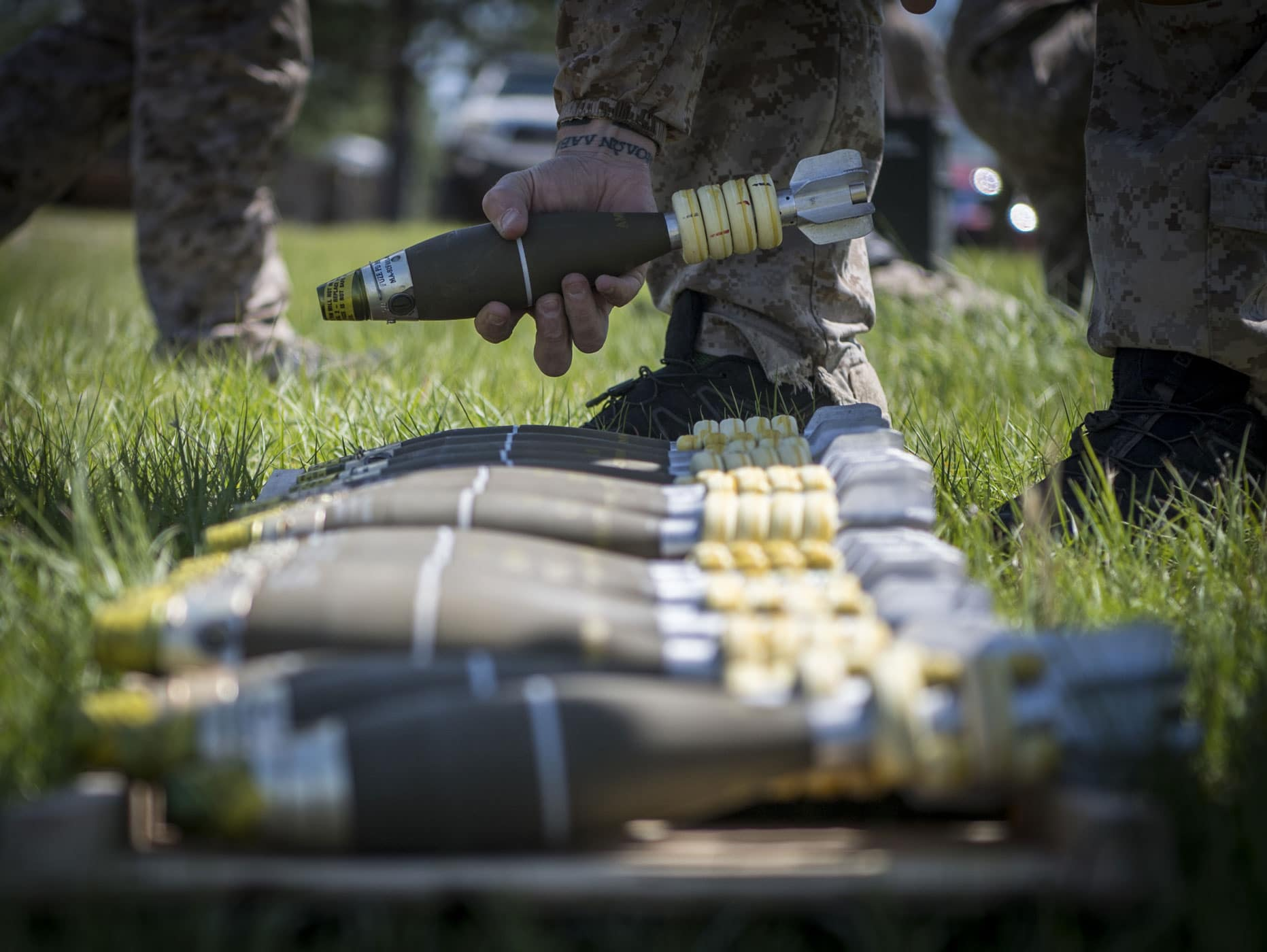 An East Coast-based Navy SEAL stacks M888 mortar rounds in preparation of indirect-fire training May 5, 2017 at Camp Shelby, Miss. during TRIDENT 17.
