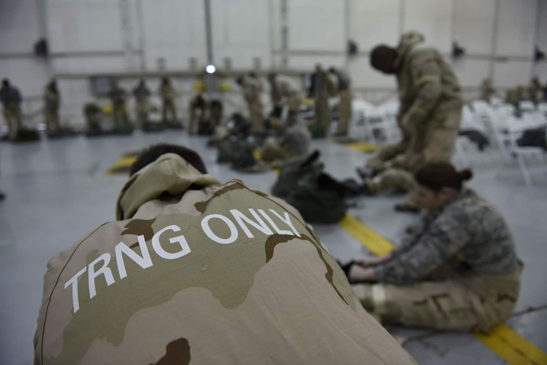 Members of the 145th Airlift Wing don Joint Service Lightweight Integrated Suit Technology during Chemical, Biological, Radiological, and Nuclear Defense training held at the North Carolina Air National Guard Base, Charlotte Douglas International Airport.