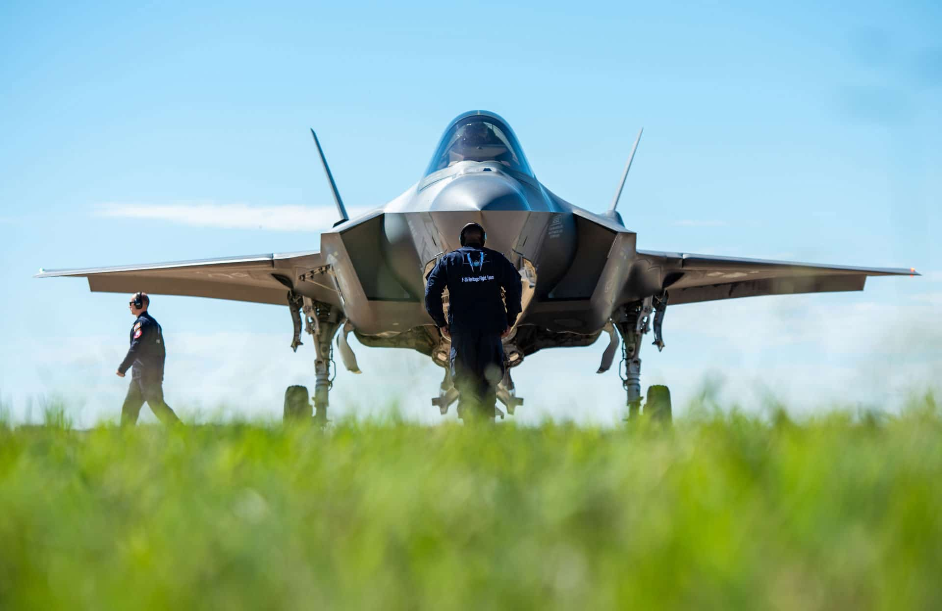 F-35 Heritage Flight Team members marshal an F-35A Lightning II upon arrival to Fort Alliance Airport. The F-35 HFT arrived at Fort Worth Alliance Airport to perform in the Bell Fort Worth Alliance Airshow.