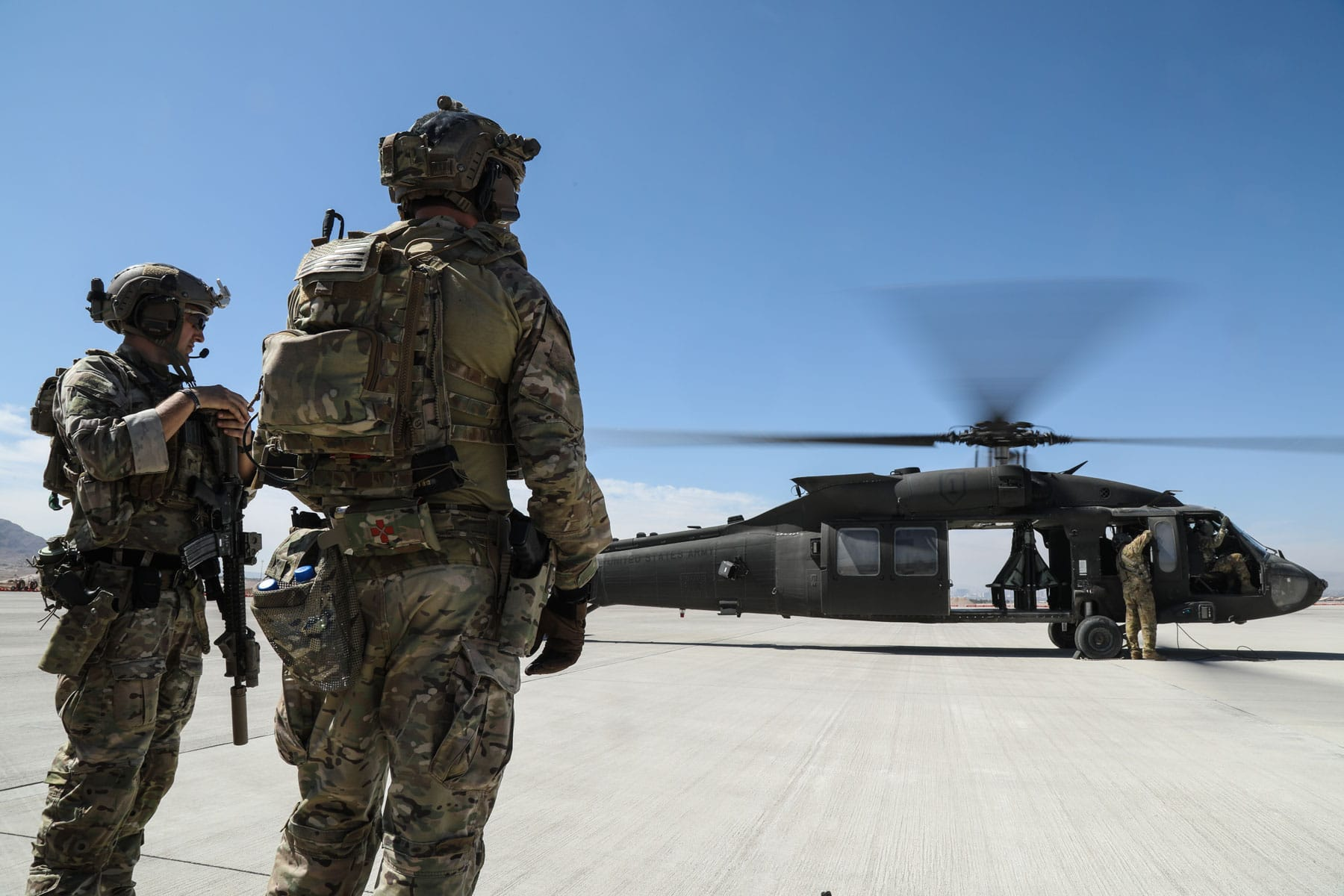 U.S. Army Special Forces Soldiers, assigned to 10th Special Forces Group (Airborne), prepare to load onto a UH-60 Blackhawk helicopter prior to executing a full mission profile on, Nellis AFB, Nevada.