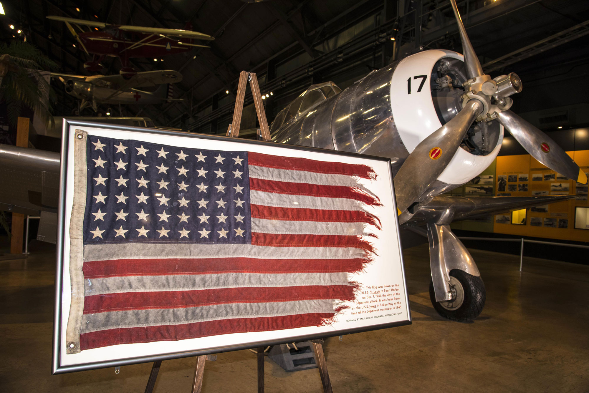 A framed American flag sits on display inside the National Museum of the U.S. Air Force in Dayton, Ohio, December 7, 2016. The flag was flown on the USS St. Louis at Pearl Harbor the day of the attacks nearly 77 years ago. It was later flown on the USS Iowa at the time of the Japanese surrender in 1945.