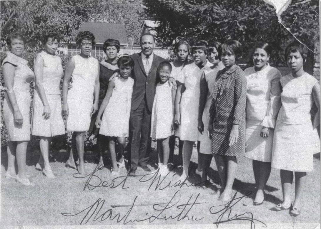 Dr. Martin Luther King Jr. was a frequent dinner guest at the Cleveland home of Julia Freeman (sixth from right), grandmother of Ohio National Guard Lt. Col. Jeffrey Watkins. In this photo, believed to have been taken outside Freeman's home in the summer or fall of 1967, King (center) is pictured with several members of Watkins' Family and friends.
