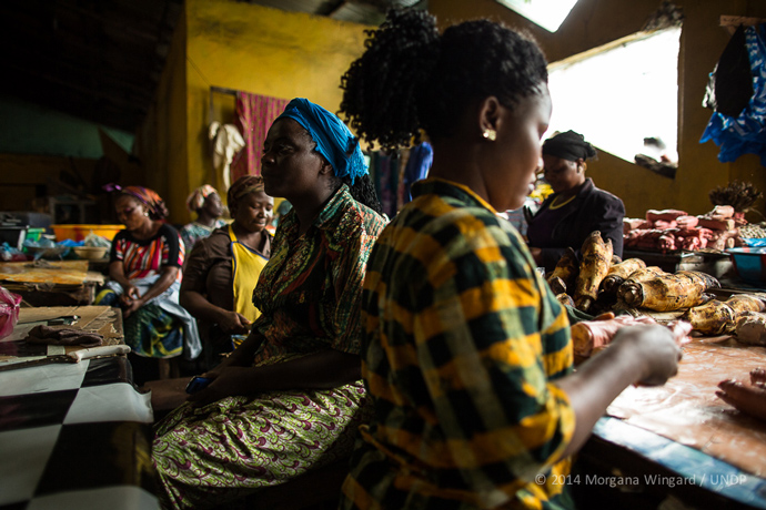Oretha Sampon, 40, sells fish in Waterside Market next to West Point in Monrovia on September 18, 2014.