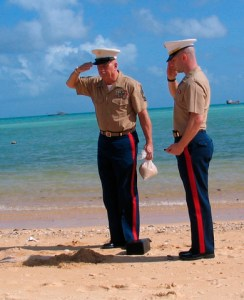 Master Sgt. James M. Fawcett, left and Capt. Kyle Corcoran salute Fawcett's father's ashes on Red Beach 1. MSgt Fawcett's father landed on Red 1 on 20 Nov 1943.