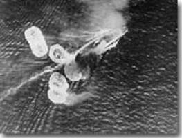 HMS Repulse hit by Japanese bombs