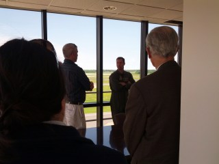 """CAPT Bob """"Goose"""" Geis, NAS Oceana commanding officer, answers questions during our time in the tower conference room."""