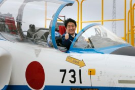 Japan's Prime Minister Shinzo Abe poses inside the cockpit of a T-4 training jet plane of the Japan Air Self-Defense Force's (JASDF) Blue Impulse flight team at the JASDF base in Higashimatsushima, Miyagi prefecture, in this photo taken by Kyodo May 12, 2013 and released on May 16, 2013. Mandatory Credit REUTERS/Kyodo