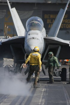 "F/A-18F Super Hornet from VFA-211 ""Checkmates"" prepares for launch aboard USS Enterprise."