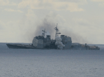 The Valley Forge (ex-CG-50) sinking off the coast of Hawaii after being used for target practice, 2 November 2006. U.S. Navy Photo.