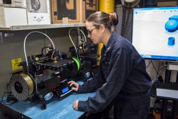 Aviation Electronics Technician 2nd Class A Figert uses a 3-D printer aboard aircraft carrier USS Harry S. Truman (CVN-75)