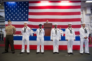 Rear Adm. John B. Nowell acknowledges the achievements of individual sailors from various commands attached to Expeditionary Strike Group (ESG) 7 during a change of command ceremony aboard amphibious assault ship USS Bonhomme Richard (LHD-6)