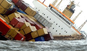 epa02279704 Containers are lose aboard the tilted cargo ship MSC Chitra after a collision with another similar vessel off the Mumbai coast, India, 09 August, 2010. At least 33 sailors on board were safely evacuated following the accident, Indian Coast Guard officials said. The ships, at least 200 meters in length, hit each other some five nautical miles off the coast of Mumbai, the report said. Due to the impact of the collision, MSC Chitra has dangerously tilted in the sea and rescue groups were seeing containers that it was carrying falling from it at regular intervals. The affected ship was loaded with an estimated 2,500 tonnes of oil at the time of the accident, but officials declined to comment on the information. EPA/DIVYAKANT SOLANKI