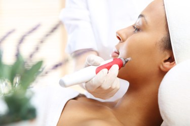 Microneedle mesotherapy treatment for neck the woman at the beau