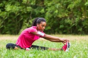 African american woman jogger stretching - Fitness people and healthy lifestyle