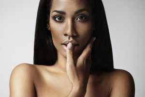 beauty black woman touching her lips with finger