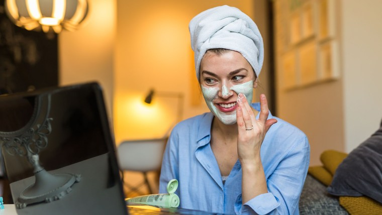 Cosmetic blogger. Woman testing new product. cosmetic face mask,