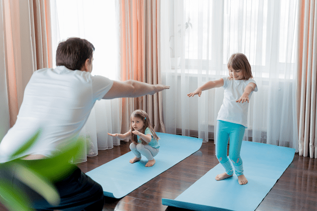 Dad and children doing yoga