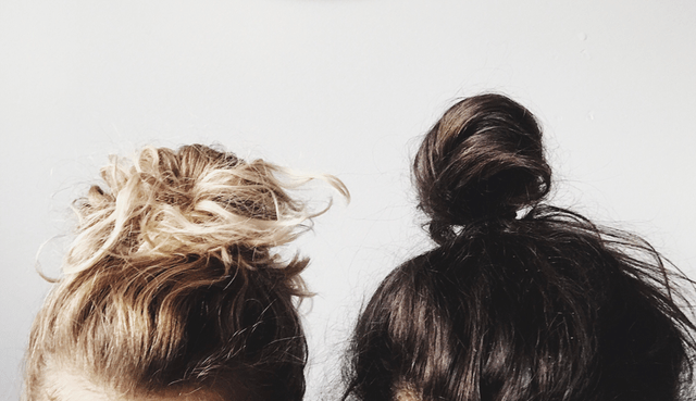 2 people with messy buns hairstyle