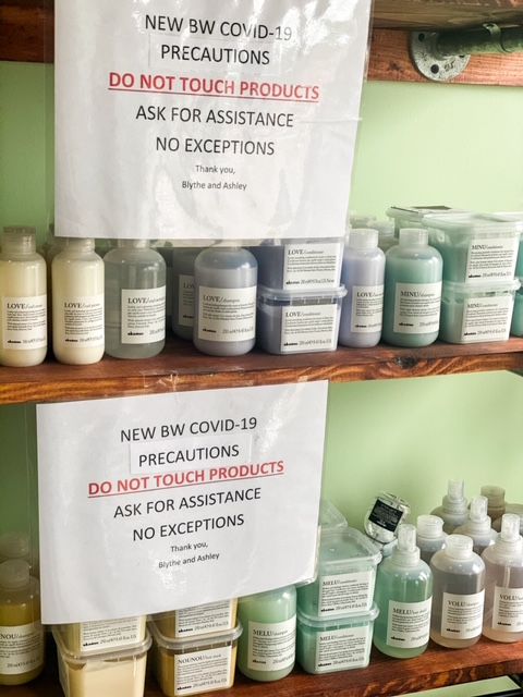 signs above merchandise that says to ask for assistance
