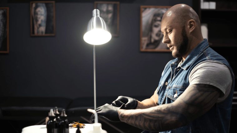 a man in a tattoo shop preparing for a tattoo