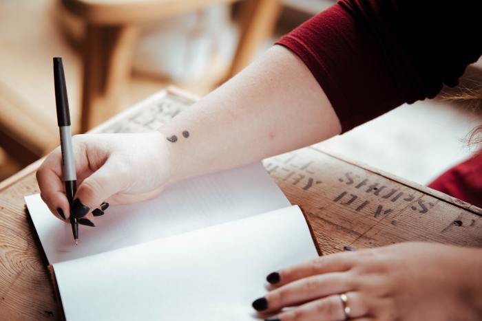 a person writing in a journal