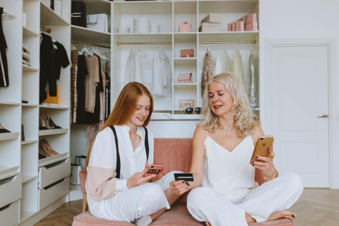 mother and a daughter online shopping