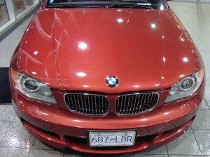Vancouver-ClearBra-2009-BMW-135i-red-Xpel-Ultimate-Paint-Protection-Film-Brian-Jessel-BMW-finished-hood-24-inch