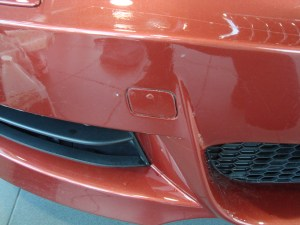 Vancouver-ClearBra-Bad-Competition-Work-2009-BMW-135i-Red-Brian-Jessel-BMW-Paint-Protection-Film-lower-bumper