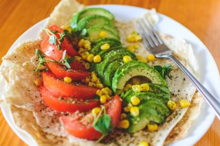 Avocado and tomato taco by Artem Bulbfish