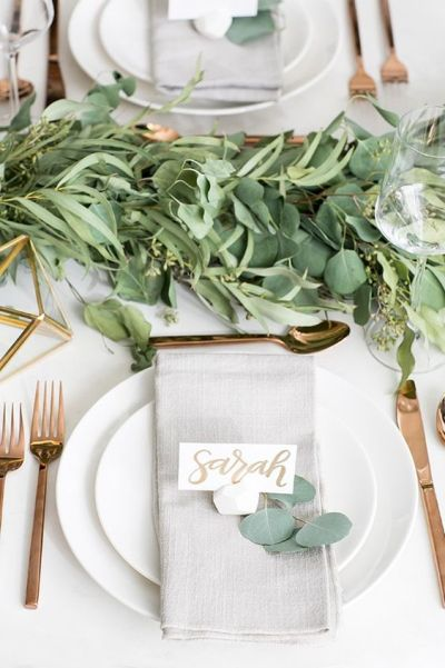 simple table setup for baby shower party with green and gold themes