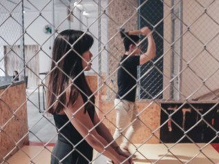 Picture of a guy and a girl throwing axes