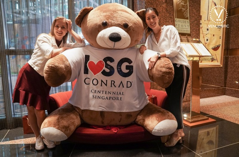 venuerific team with huge teddy bear from conrad singapore