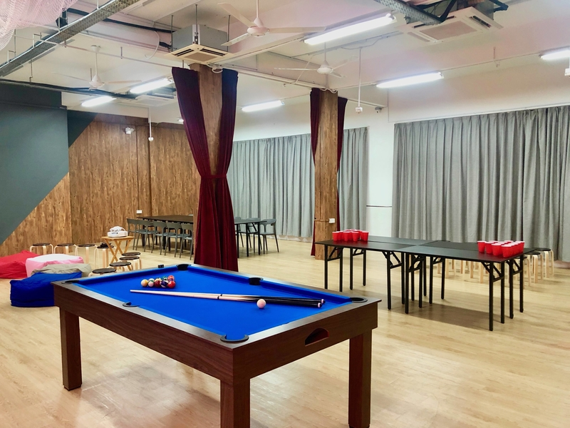 event space with pool table and beer pong