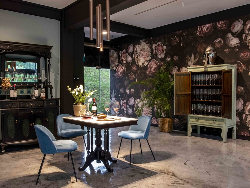 private dining restaurant in singapore with flowers decoration and blue chairs