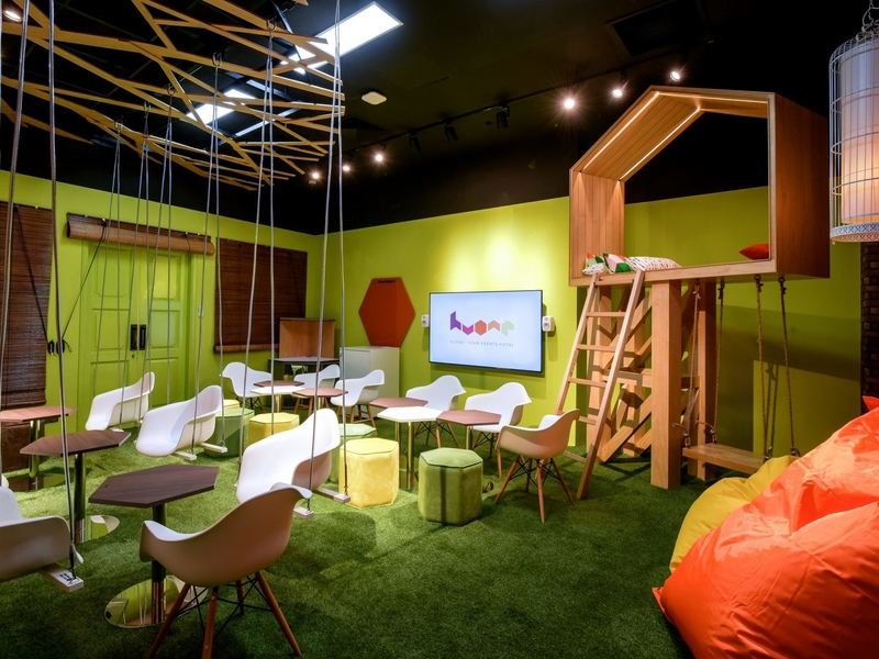 swing room theme equipped with colourful beanbag and grass floor