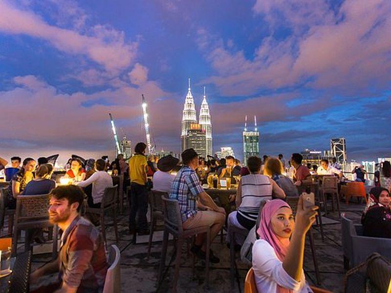 helipad rooftop bar with a panoramic view of the Kuala Lumpur city skyline