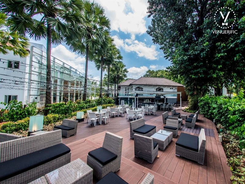 large outdoor wedding venue in singapore with garden area and wooden floors