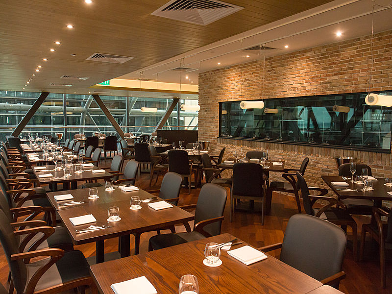 glass wall restaurant in singapore with square dining table