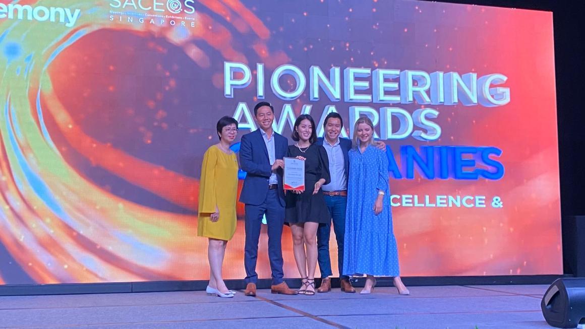 venuerific team posing in award ceremony