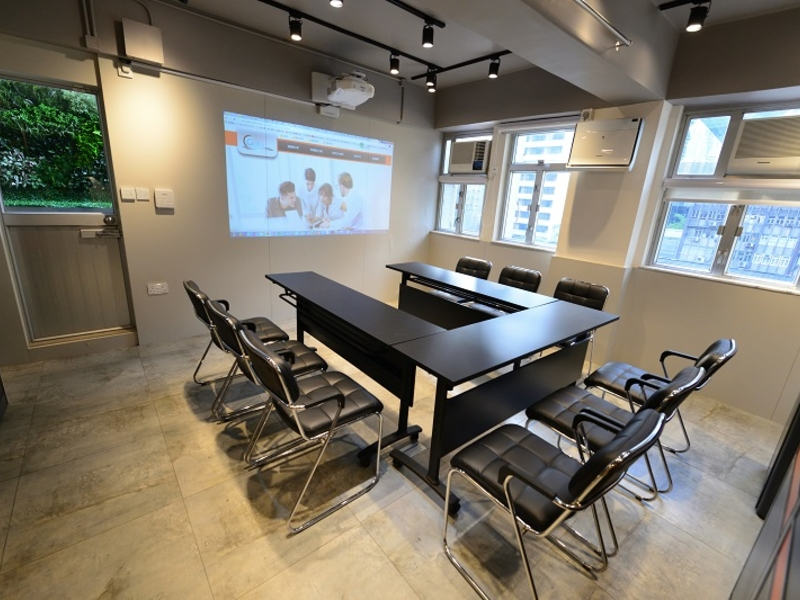 private meeting room using u shape setup and well eqquiped with screen projector