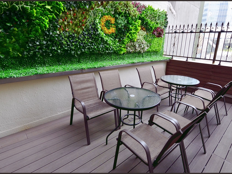 outdoor terrace area with some table and chairs